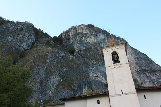 Griante, Italy: San Martino bell tower with mountain behind