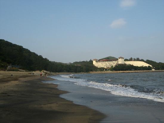 Grand Coloane Resort Macau: View of hotel from beach 