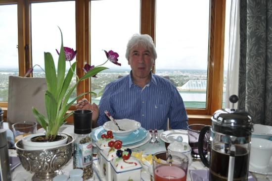 Dyers House: Monika's pic of me at Breakfast with Christchurch background.