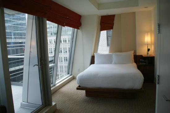 The Gotham Hotel: Room and glass wall to balcony