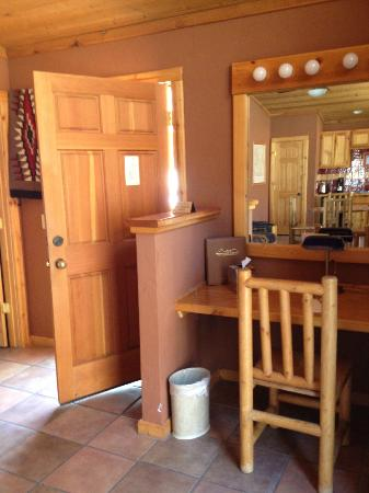 Red Cliffs Lodge: front door and desk in 2 bedroom cabin