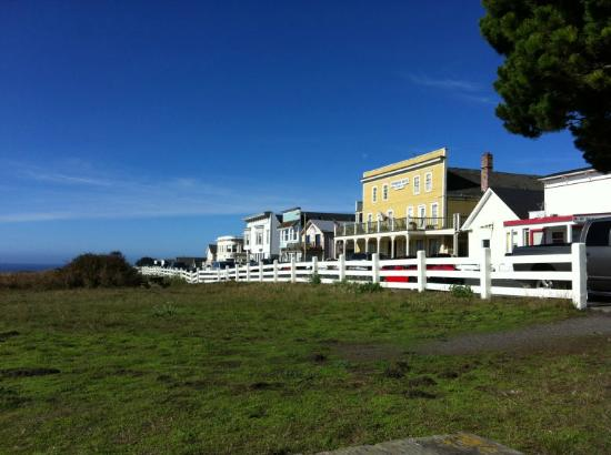 Mendocino Hotel and Garden Suites: The hotel (yellow) overlooks a meadow and the ocean.