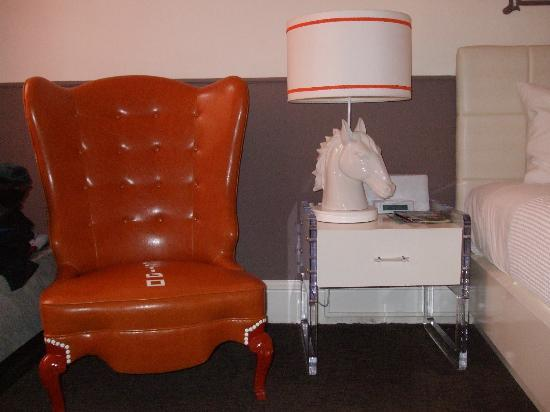 Hotel Vertigo: Two features of Vertigo rooms - bright orange chair & horsehead lamps