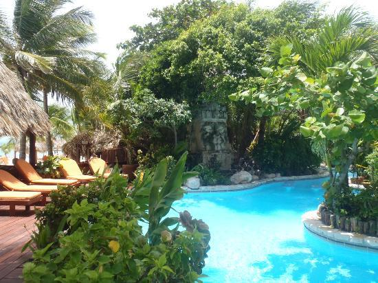 Ramon's Village Resort: pool surrounded by lush gardens