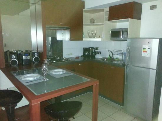 Plaza Suites Apartments: Cocina Comedor