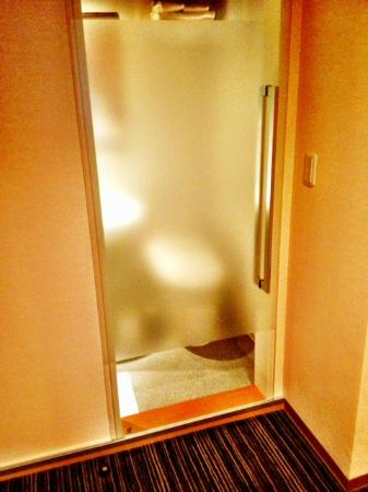 The B Ikebukuro: Semi-private bathroom door.  Don't worry - there's a partition between the bathroom and living a