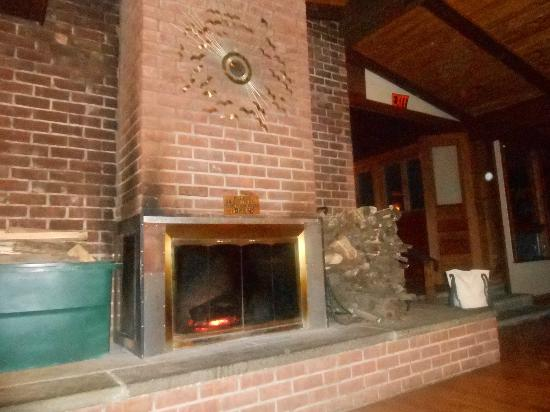 Total Tennis: Living room! Cozy fireplace.