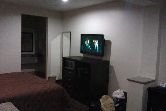 Super 8 Houston North I-45: Entertainment Center with flatscreen, microwave, mini fridge and wall mirror