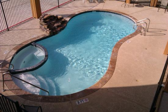 Super 8 Houston North I-45: Pool with stone waterfall fountain and hot tub