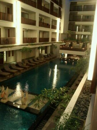 The Magani Hotel and Spa: 1st floor balcony view of the pool at dusk