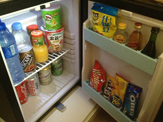 Cosmo Hotel Hong Kong: Bar fridge - these items aren't free!