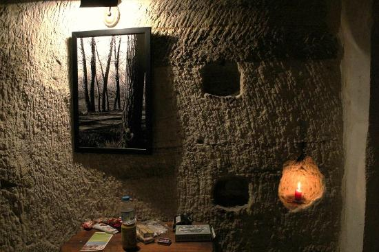 Terra Cave Hotel: small random holes in the walls with candles for romantic setting, room 504