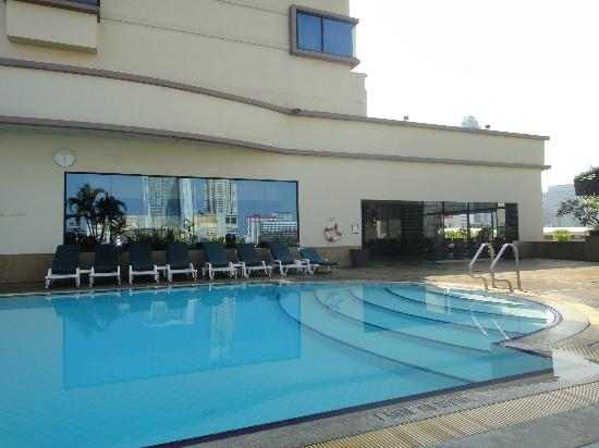 Ramada D MA Bangkok : Pool with Bangkok reflected in gym windows