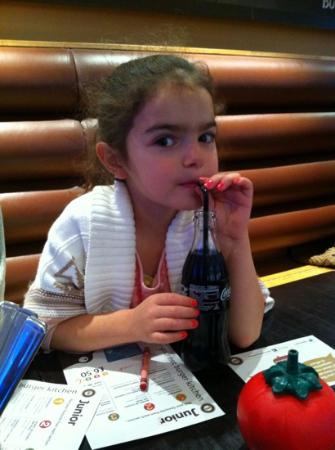 Gourmet Burger Kitchen: my daughter enjoying her meal