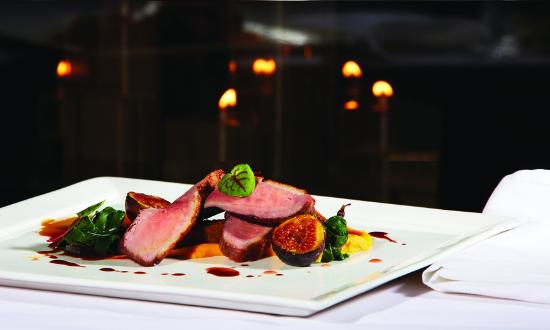 Grouse Mountain Grill: Duck Breast, caramelized figs, duck confit, beet greens, duck demi-glace