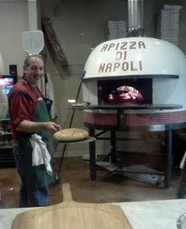Apizza Di Napoli: Owner Cliff in front of imported fire brick oven from Italy