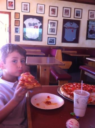 Lamppost Pizza: jake eating his favorite pepperoni w diced tomatoes !