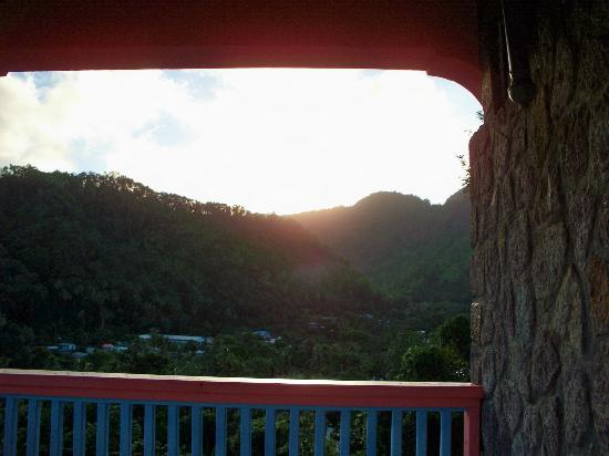 Calabash Mountain Villa: View of sun rising over the mountains from a room