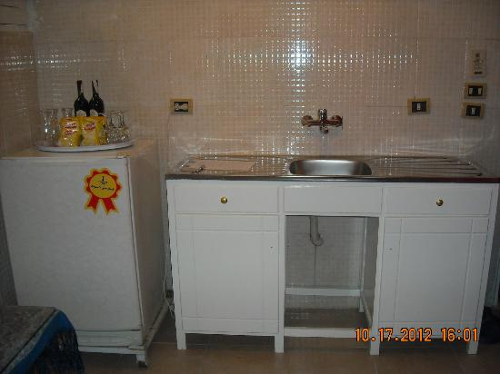 Mara House: Kitchenette - sink and refrigerator