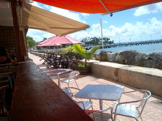 Orange Street Grocer: Speightstown Esplanade and Pier from outside deck