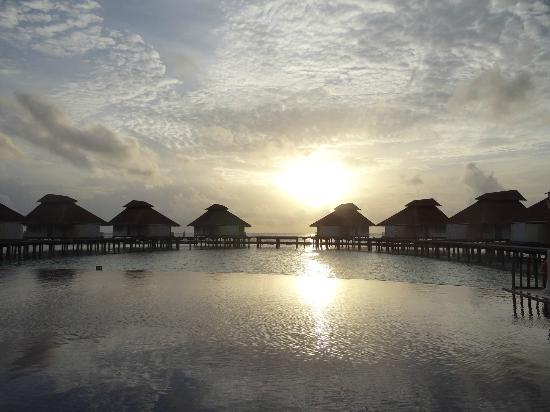 Ellaidhoo Maldives by Cinnamon: nightfall at the far side of the island - pool and water bungalows