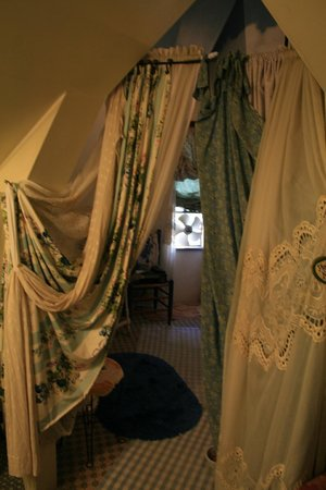 Enchanted Nights B&B: More boudoir curtains in doorway leading to bed area