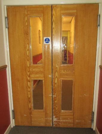 Shepherds Hotel: just one set of the badly bashed doors in the corridor
