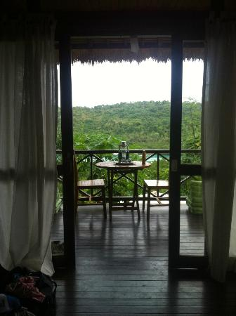 Twin Island Villas: View of my table and deck from bed