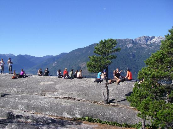 The Howe Sound Inn & Brewing Co. : People sitting on top of Squamish Chief Look-out #2