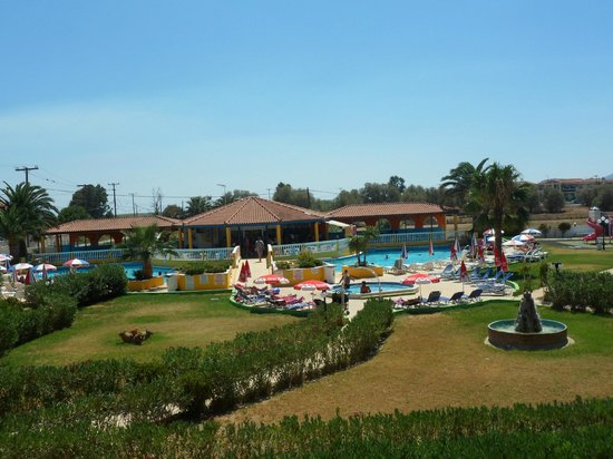 Exotica Hotel: view of pool and barside pool and gardens from room 216