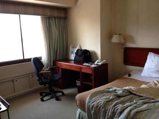 AIM Conference Center Manila: bed and desk, again sorry the mess i took this photo hen i woke up