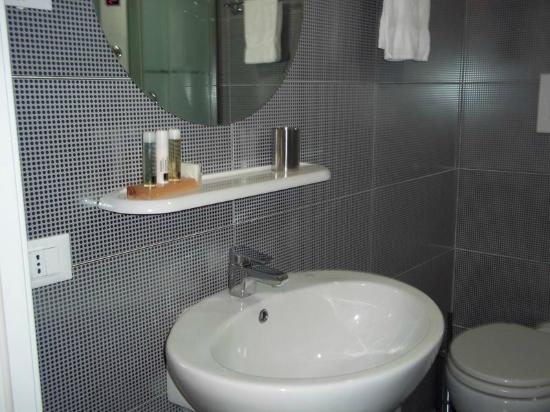 The Place Cagliari: Bathroom with sink and toiletries