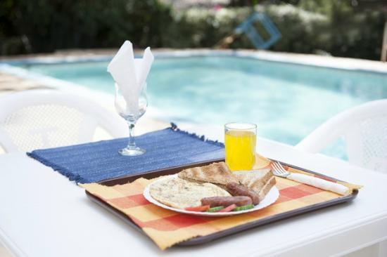 Eden Gardens: Breakfast by the pool
