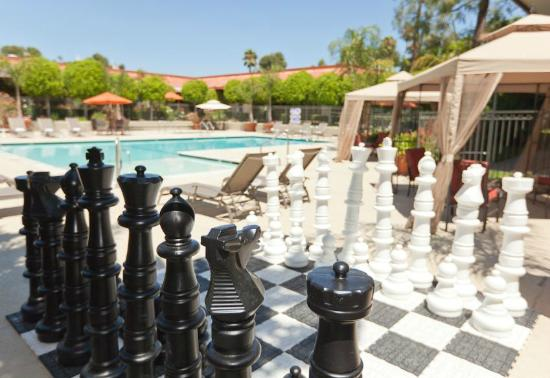 Palm Garden Hotel: Life-Size Chess by the Pool