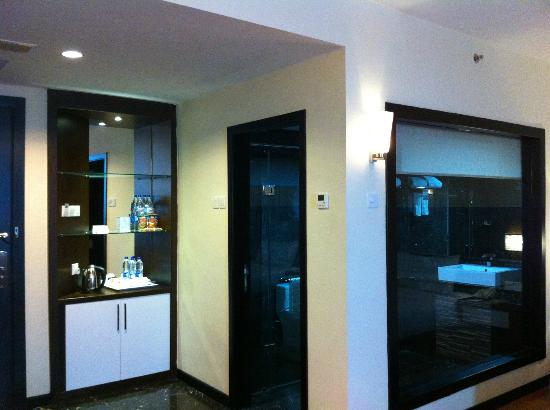 The BCC Hotel & Residence: view of room and entrance to bathroom