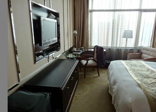 Friendship Hotel Hangzhou: general view - LCD TV table for laptop, lounge chair etc