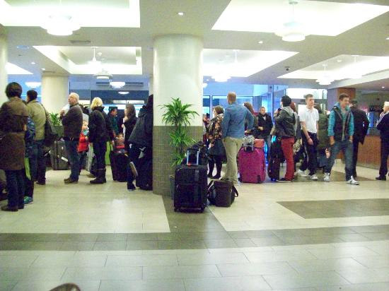 Royal National Hotel: Waiting in line for check-in to the left desk.