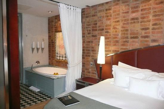 African Pride Melrose Arch Hotel: our bedroom into bathroom