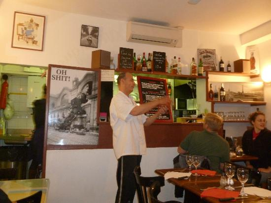 La Varangue: Philippe explaining the menu which is on a blackboard.