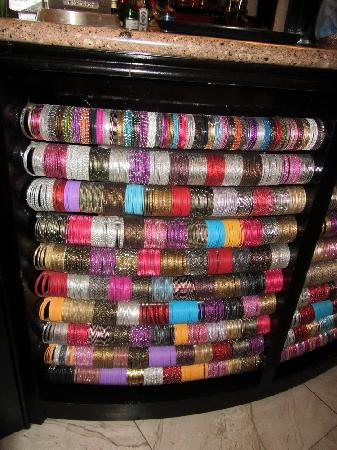 Indian bangles decorating the front of the bar - Picture of