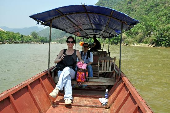 Custom Vietnam Travel Day Tours: Traveling on boat from hike to Lao Cai village for lunch