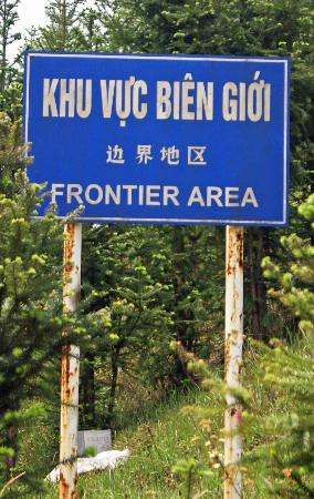 Custom Vietnam Travel Day Tours: Ha Giang road sign