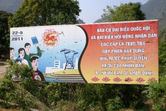 Custom Vietnam Travel Day Tours: Ha Giang road billboard