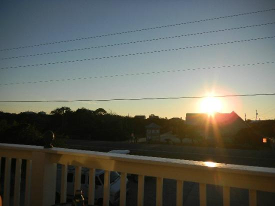 Cape San Blas Inn: View of the sunset from the front balcony of the Coquina room.