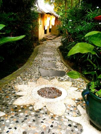 Oasis Secret Garden Spa: the rustic stone passage that good for the sole of feet.,, conscious movement