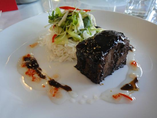 Relish Waterfront Dining: Braised beef belly with a Thai BBQ marinade, coconut steamed rice, lime and pickled cucumber sal