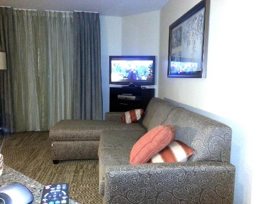 Staybridge Suites Torrance: Living room w/ new couch, paintings, and HDTV