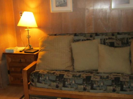 Hither House Cottages: Livingroom,couch that opens up to be a fulton bed