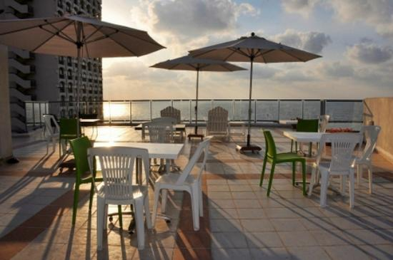 The Maxim Hotel: Our roof deck at sunset
