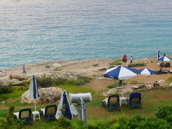 Atlantica Sungarden Beach: sun loungers on cliff side and grass areas